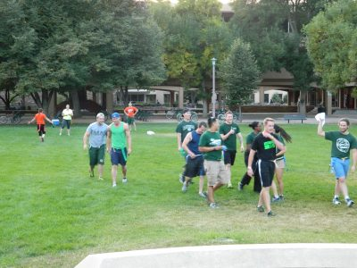Students on the grass playing capture the flag