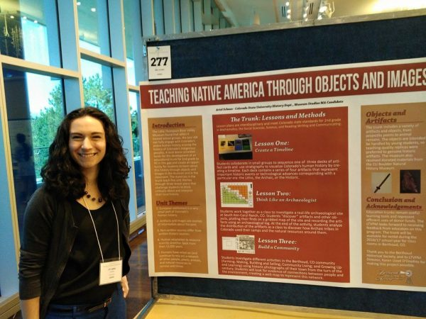 Ariel Schnee standing with her poster