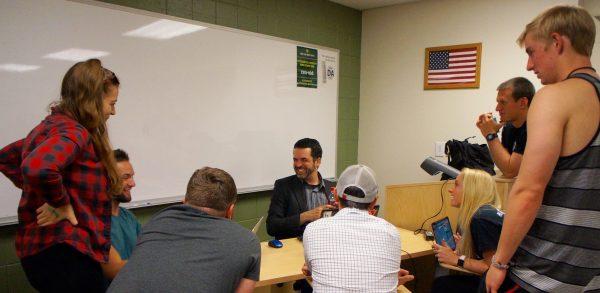 Robert Jordan speaking with students during class