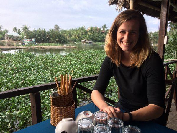 Elizabeth Bruns sitting on a terrace in Vietnam