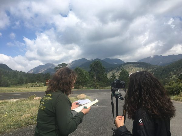 Students photographing Rocky Mountaint National Park and taking historical notes
