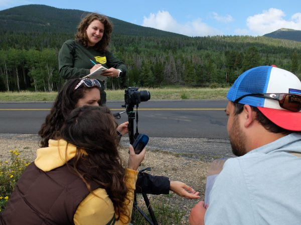 Students working with a camera at Rocky Mountain National Park