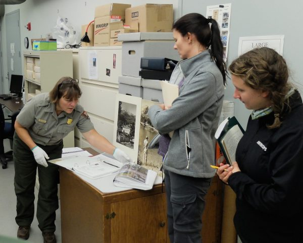 A student and PLHC Admin, Brenda Todd, work with a conservator at Rocky Mountain National Park