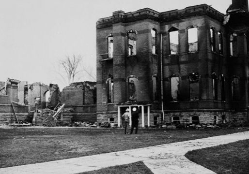 Two men looking at CSU's Old Main after it burned in 1970