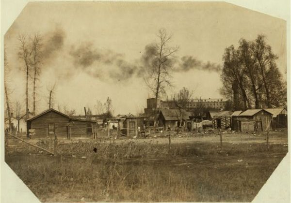an old photograph of rough houses in Fort Collins