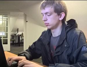 Logan Haas typing on a laptop