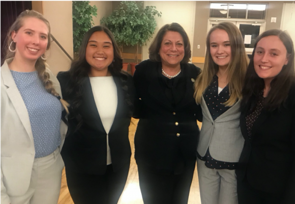 Simon with other interns at a town hall