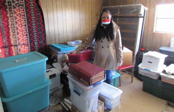 Yufna Soldier Wolf standing with her fathers collected materials